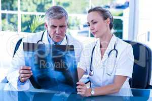 Medical team looking at xray together