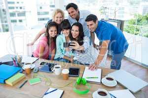 Creative business team taking a selfie