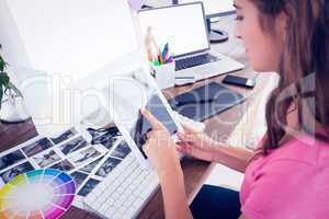 Creative young businesswoman using tablet