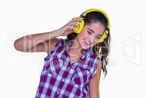 Pretty brunette listening music with headphone