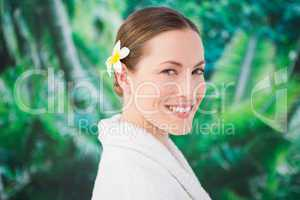 A beauitful young woman with a flower in her hair
