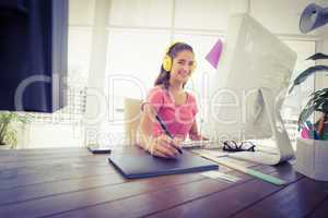 Creative businesswoman writing on a tablet