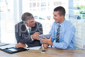 Businessmen working together with tablet