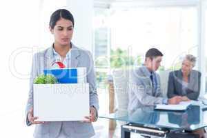 Businesswoman carrying her belongings in box