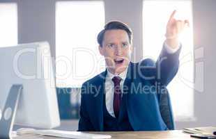Angry businessman pointing and shouting