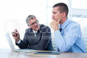 Businessmen working together with laptop and tablet
