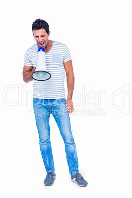 Standing man shouting through megaphone