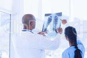Doctors analyzing together xray