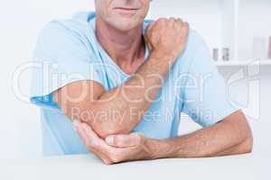 Man suffering from elbow pain