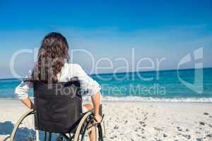 Disabled woman looking at the ocean