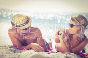 Cute couple tacking photos on the beach