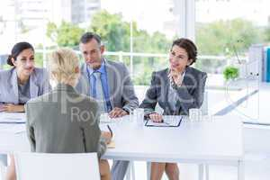Interview panel listening to applicant