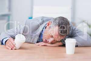 Sleeping businessman in his office