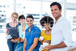 Business people eating donuts and drinking
