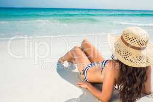 Rear view of pretty brunette looking at the ocean