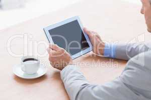 concentrating businessman using a tablet