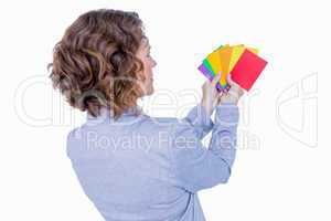 Businesswoman looking at colors cards