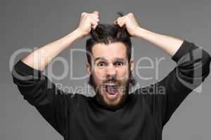 frustration, man tearing hair out in anger