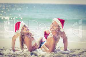 Lying cute couple wearing christmas hats