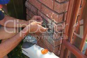 process of wood door hinge installation.