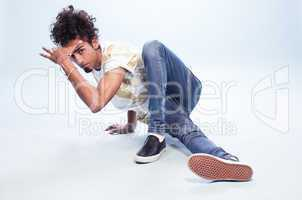 Male Dancer in a Hip Hop Pose on the Floor
