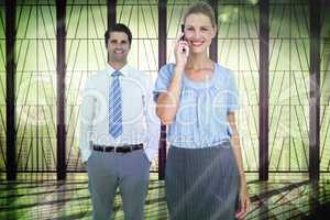 Composite image of businesswoman having phone call while her col