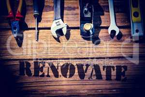 Renovate  against desk with tools