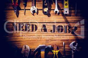 Need a job? against desk with tools