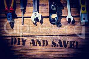 Diy and save! against desk with tools