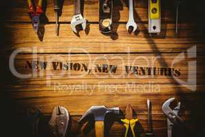 New vision, new  ventures against desk with tools