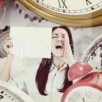 Composite image of shouting brunette holding page