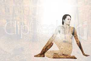 Composite image of fit woman doing the half spinal twist pose in