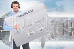 Composite image of businessman showing card wearing headset