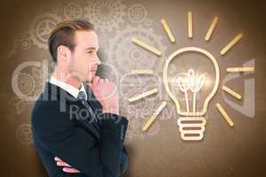 Composite image of thinking businessman standing with hand on ch