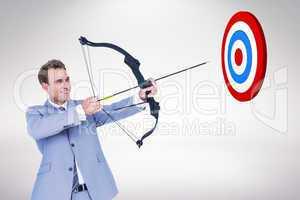 Composite image of businessman shooting arrow