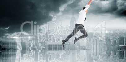 Composite image of flying businessman