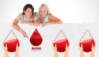 A blood donation sign being pointed at