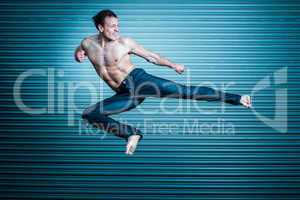 Man in jeans performing a kick. Martial arts