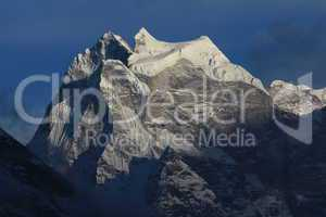 Majestic peak of Kangtega at sunset