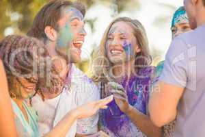 Friends having fun with powder paint