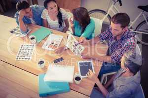 Seated creative business team working together
