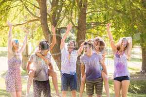 Young friends having fun with hose in the park