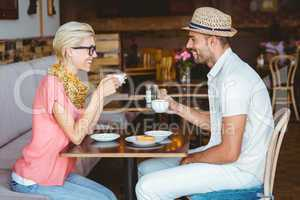 Cute couple on a date talking over a cup of coffee