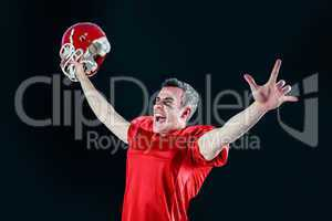A triumph of an american football player without his helmet