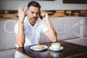 Young man angry on the phone