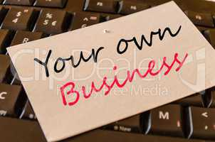 Your own business concept on keyboard