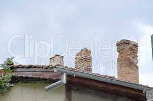 Tile Roof With Brick Chimneys