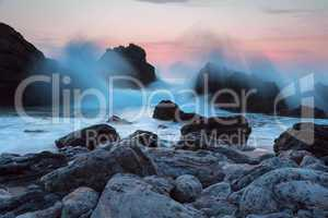 Evening Ocean Surf on a Rocky Shore