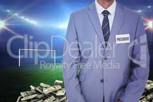 Composite image of businessman with badge