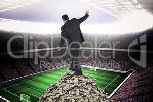 Composite image of mature businessman doing a balancing act